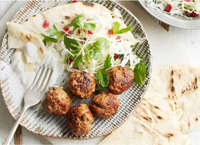 Harissa lamb meatballs with cabbage and  pomegranate salad